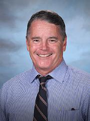 Head shot of male teacher