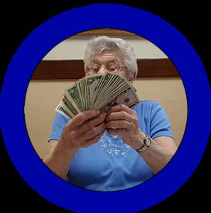 Elderly woman holding winnings at bingo