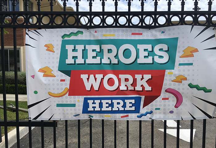 Banner with text Heroes Work Here