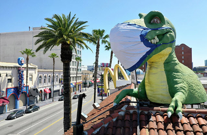 Giant inflated reptile with surgical mask