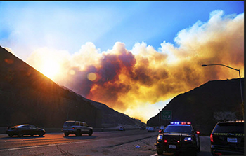 Skirball Fire on hillside moving towards 405 Interstate Freeway, Los Angeles County California